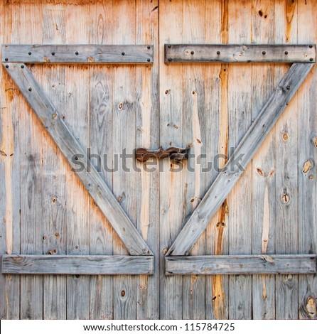 detail of wooden barn door - stock photo