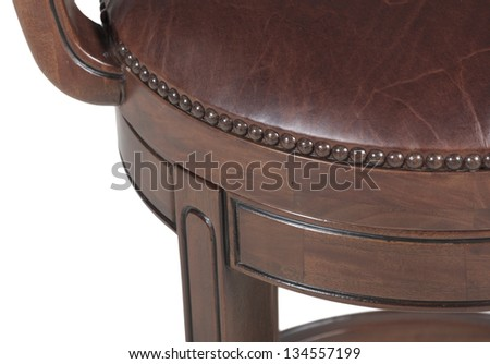Detail of wooden chair with leather upholstery - stock photo