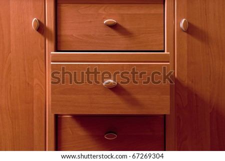 Detail of wooden chest of commode - stock photo
