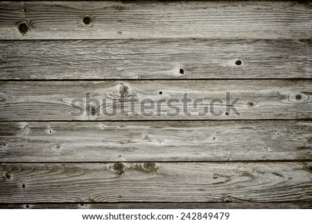 Detail of wooden fence, several boards, knots and nails - stock photo