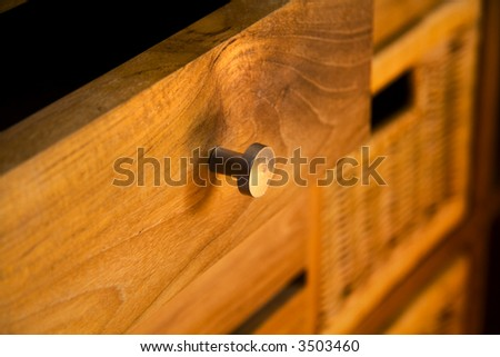 Detail of wooden furniture with drawers - stock photo