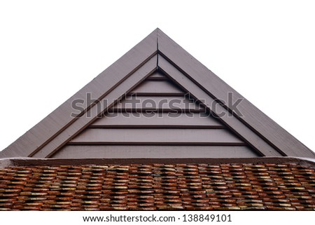 detail of wooden roof gable with clay roof tile on white cloudy sky