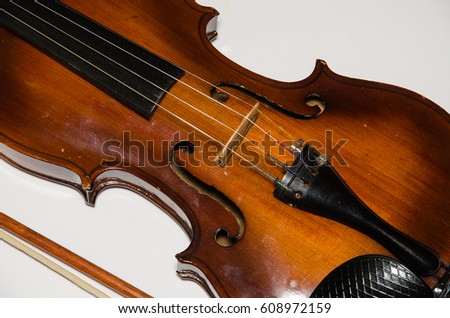 Detail of wooden violin isolated on white background