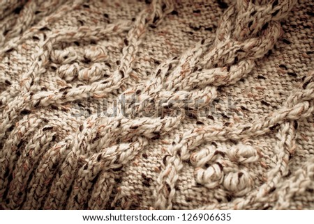 Detail of woven handicraft knit woolen design texture and knitting needle. Fabric beige background - stock photo