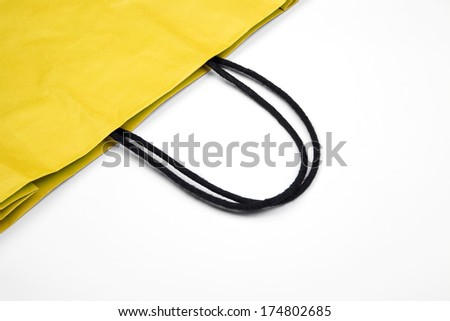 Detail of yellow shopping bag with space for your logo or text.