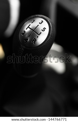 Detail on a gear stick in a new car - stock photo