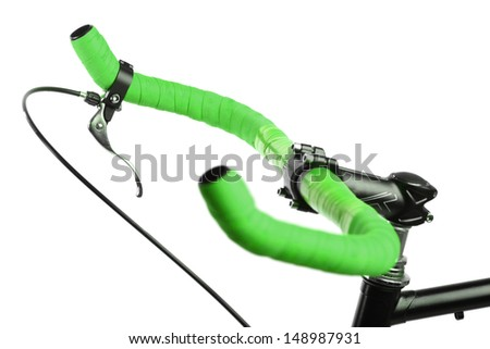 Detail on a handlebar of a bicycle with one brake - stock photo