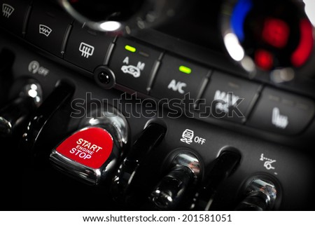 Detail on a red start button in a car. - stock photo