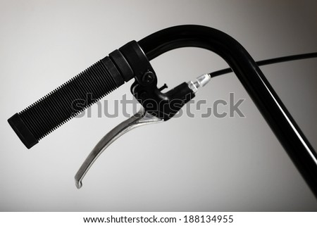 Detail on a retro handlebar of a bicycle with one brake. - stock photo