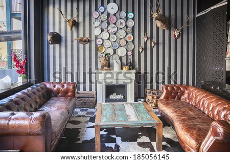 detail on interior of restaurant with fireplace - stock photo