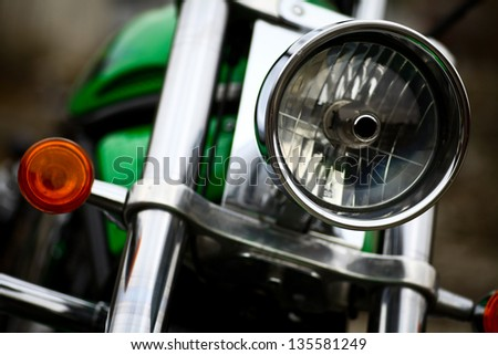Detail on the headlight of a classic motorcycle - stock photo