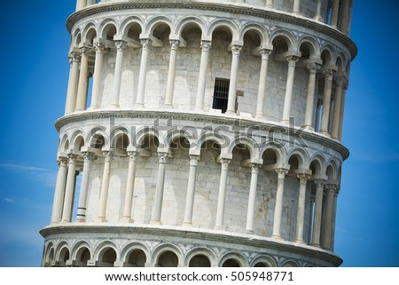 Detail on the Leaning Tower of Pisa in bright sunlight