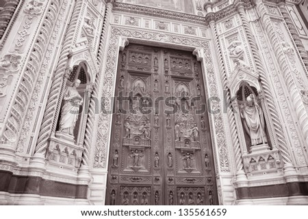 Detail on the Main Door and Facade Doumo Cathedral Church, Florence, Italy in Black and White Sepia Tone