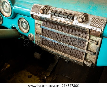 detail on the radio of a vintage car - stock photo