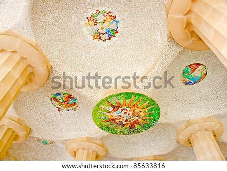 Detail on the roof of a building in park Guell designed by Antonio Gaudi in Barcelona Spain - stock photo