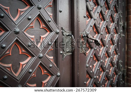 detail part of decorative old wooden church door with ornament - stock photo