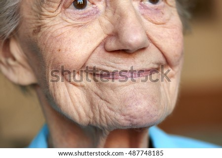 Detail portrait of an elderly women on black background