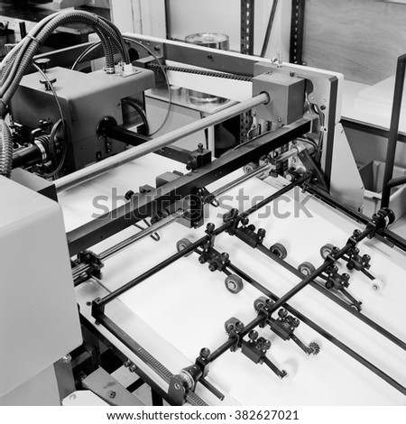 Detail shot in Black and white of the workings of a printing factory. - stock photo