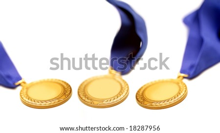 detail shot of a gold medals with blue ribbon - stock photo