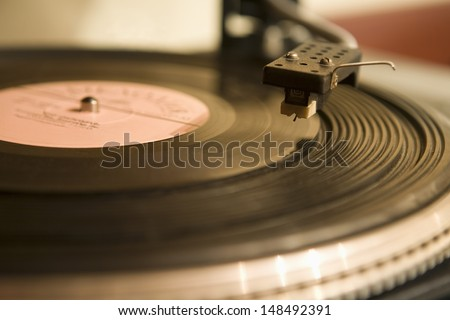 Detail shot of a record player - stock photo