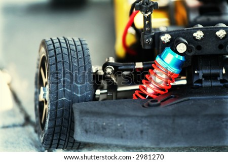 Detail shot of an automobile wheel and open engine. Car tuning concept - stock photo