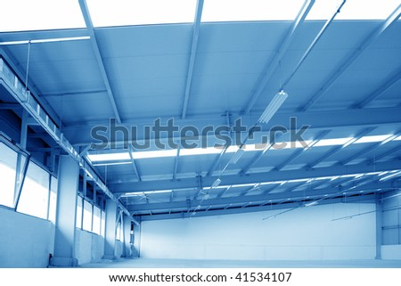 detail shot of an empty hangar warehouse - stock photo
