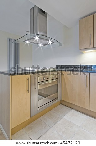 detail shot of modern kitchen counter with built-in oven - stock photo
