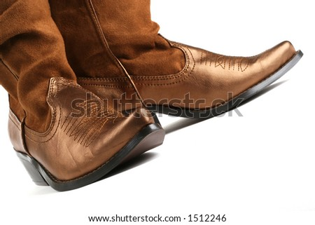 detail shot of pair of cowgirl boots - stock photo