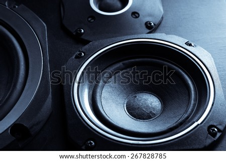 Detail shot of some old round speakers. - stock photo