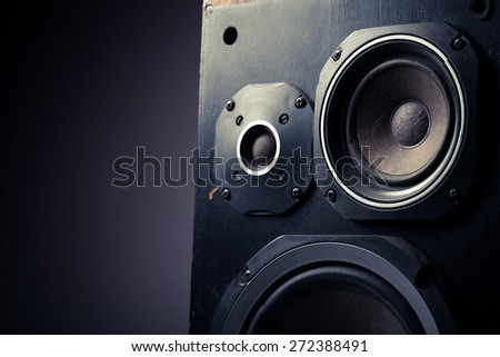 Detail shot of some old round speakers, with copyspace. - stock photo