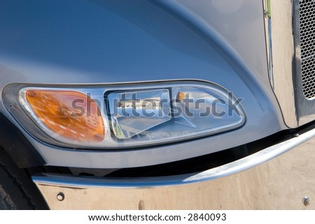 detail shot of the front headlights of a semi truck - stock photo