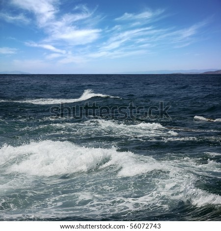 detail shot of wave splashing to the beach - stock photo