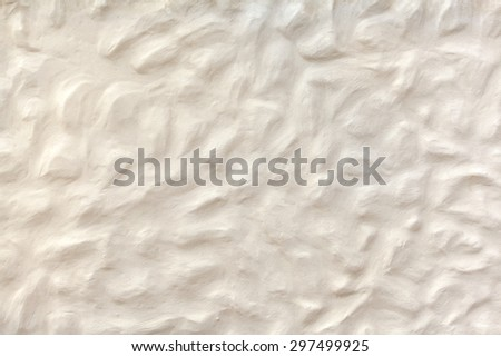Detail shot of white-beige plasterwork with an abstract bumpy surface, taken at a house on Lanzarote, Canary Islands, Spain.