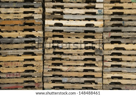 Detail shot of wooden pallets stacked in distribution warehouse - stock photo