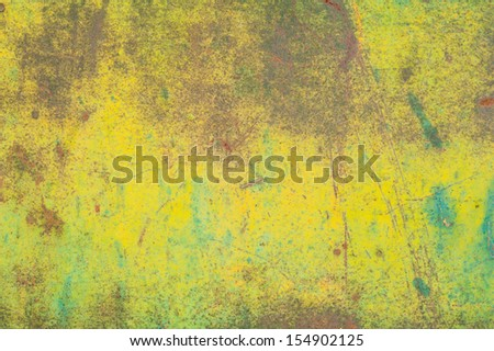 Detail shot showing the texture of yellow and green weathered metal. - stock photo