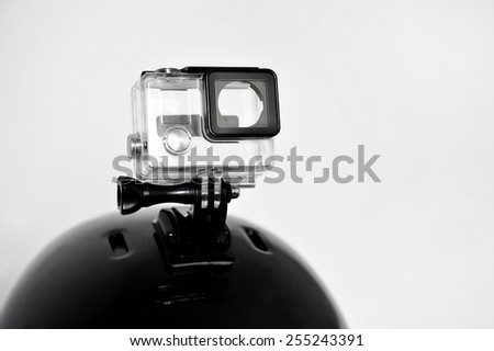 Detail shot with high definition action camera housing mounted on a sports helmet - stock photo