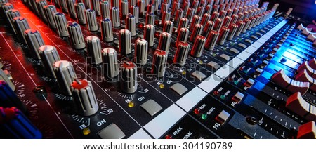 detail sound mixer in red and blue light with great perspective, the version with great detail controls - stock photo