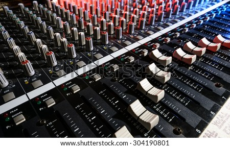 detail sound mixer in red, white and blue light with great perspective, the version with great detail controls - stock photo
