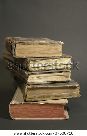 detail studio photography showing a stack of historic books - stock photo