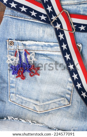 Detail suspenders on old washed jeans - stock photo