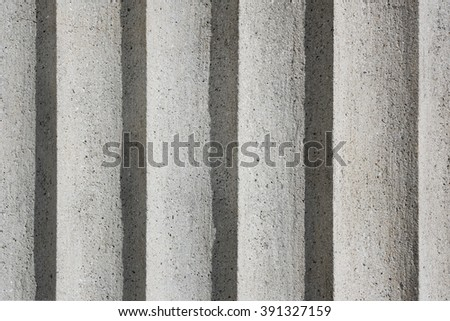 detail textured plaster on historic building, unique structure, rugged construction facade - stock photo