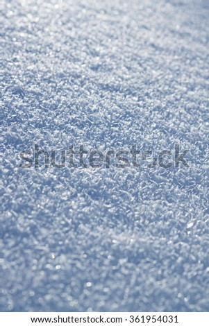 detail the frozen snow against sun, close-up snow crystals - stock photo