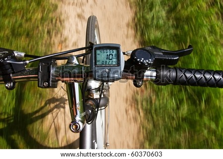 detail the handlebars of a bicycle while driving - stock photo