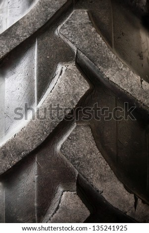 Detail up close of a tire tread from a tractor or other heavy duty construction machinery