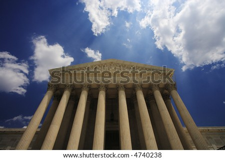 Detail view looking up at the entrance to the United States Supreme Court Building, Washington, DC. - stock photo