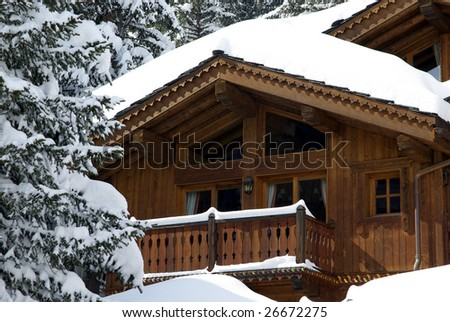 Detail view of a luxurious log cabin in the Alps in France. - stock photo