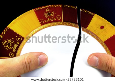 Detail view of a person repairing a broken plate. - stock photo