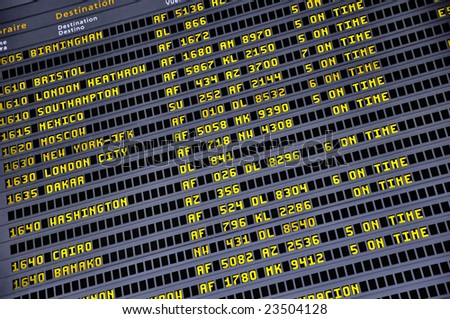 Detail view of a typical airport information board. - stock photo