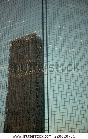 Detail view of an office building with building reflection - stock photo