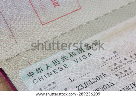 Detail view of chinese visa in a passport with stamp - stock photo